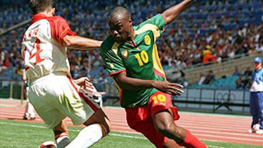 Former Cameroon international Patrick Mboma (R) in action. Net photo.