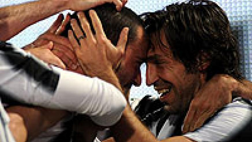 Juventus players celebrate their team's win that takes them above AC Milan. Net photo
