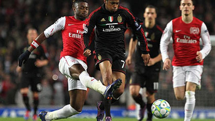 Robinho vies with Alexandre Song during their UEFA Champions League match in London. Arsenal won 3-0. Xinhua-Tang Shi