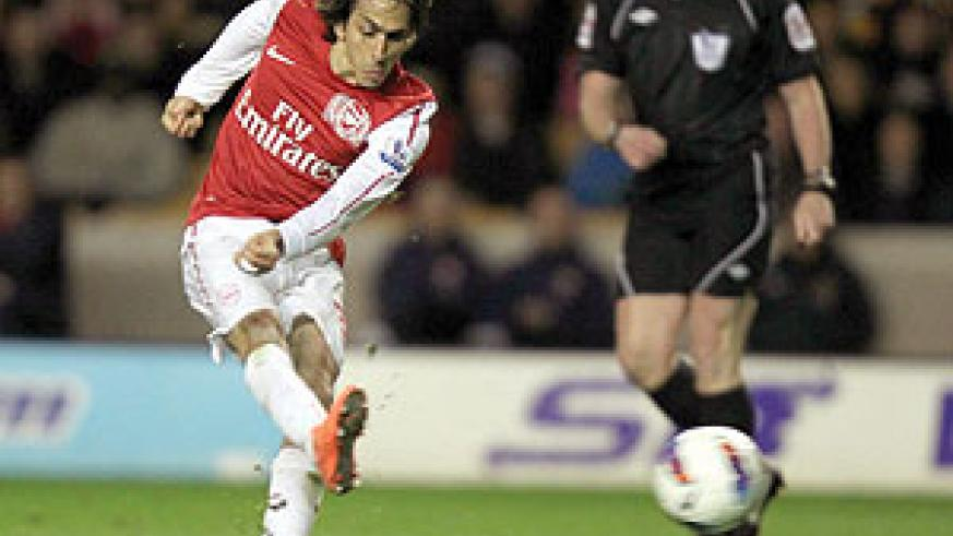 Yossi Benayoun scores in Arsenal's 3-0 over Wolves in their last match. The Gunners host Wigan hoping to tight their grip on third place. Net photo.