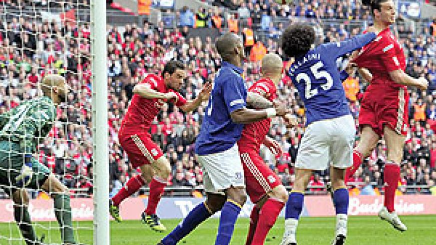 Craig Bellamy swings in a free-kick from the left and Andy Carroll does a great job of losing Fellaini to glance a header home. Net photo.