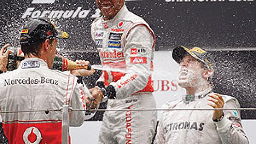 Nico Rosberg (right) celebrates his win in China with Jenson Button and Lewis Hamilton. Net photo.