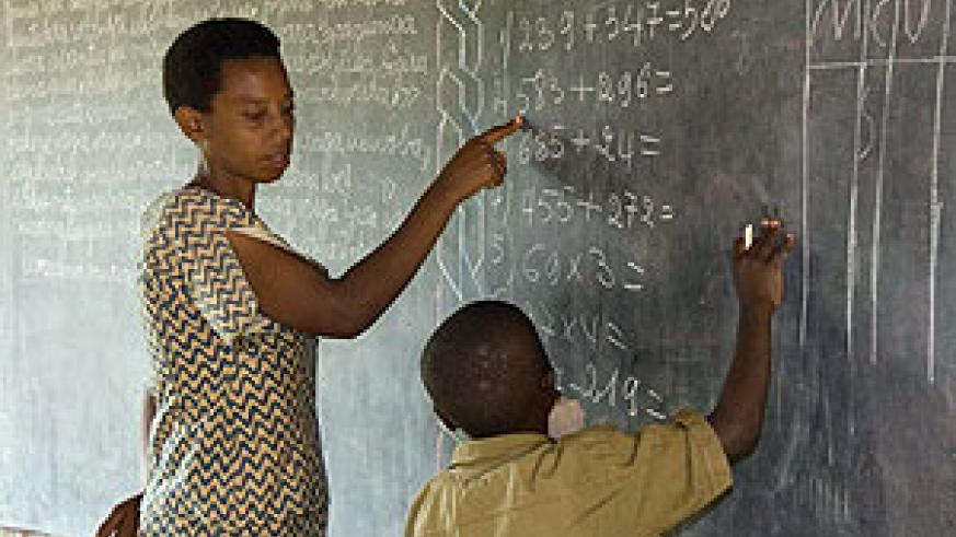 A teacher and a pupil: Rwanda has been proactive in attracting qualified labour from other EAC countries.  The New Times / File.