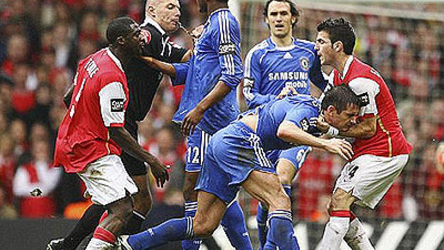 Hold on: Fabregas (right) grabs Lampard in the 2007 Carling Cup final. Net photo.