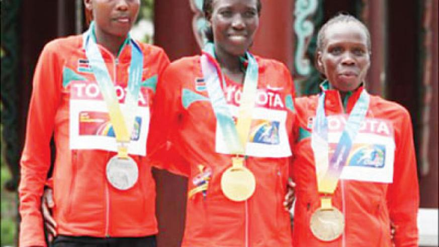 Gold medalist Edna Kiplagat (C) poses with the marathon squad after the marathon final at the IAAF World Championships in Daegu, South Korea. Net photo.