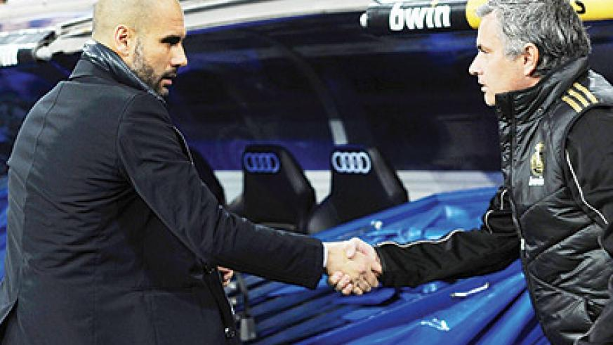 Barcelona's outgoing Manager Pep Guardiola (L ) with Real Madrid's Jose Mourinho. Net photo.