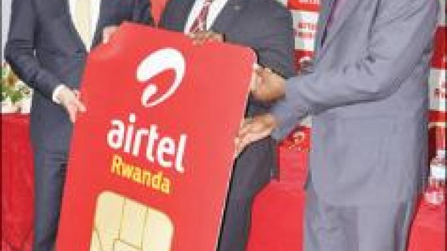 Prime Minister, Damien Habumuremyi with Airtel officials launch  the firm's operations in Rwanda.