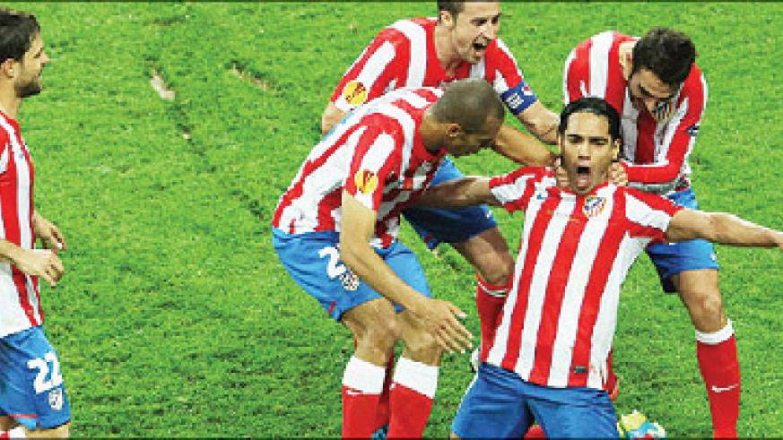 Atletico Madrid players celebrate Falcao's second goal in the Europa League final against Athltico Bilbao. Atletico is one of three clubs eyeing fourth place in La Liga. Net photo.