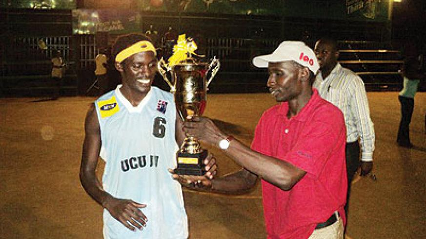 Habiyaremye Patrick Mwihoreze receiving the Division three championship trophy last year.