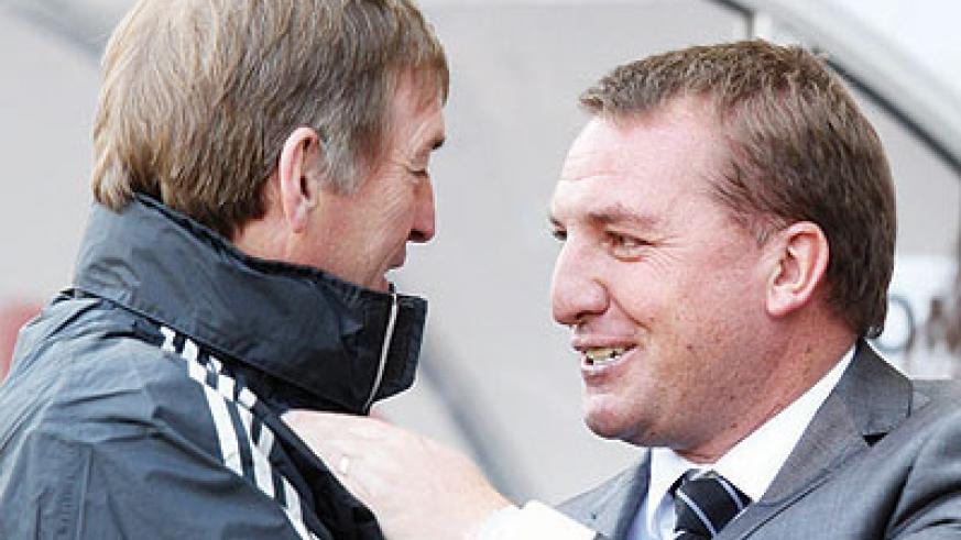 Brendan Rodgers (R) replaces Kenny Dalglish (L) as Liverpool boss. Net photo.