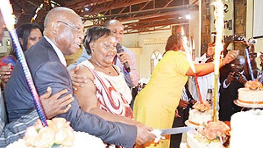 Pastor Leo Rucibigango and his wife Daphrose at their Golden Jubilee celebration service at Kimisagara Restoration Church. The New times / Patrick Buchana.