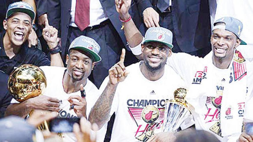 Dwyane Wade, LeBron James and Chris Bosh made amends for losing in last year's finals by getting the job done this season. Net photo.