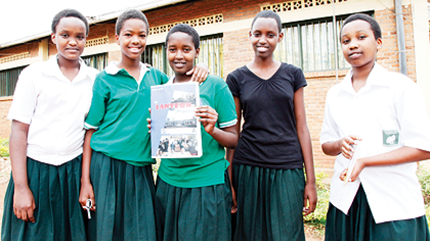 Some of the members of Lantern Group displaying their magazine. The New Times / T. Kisambira.