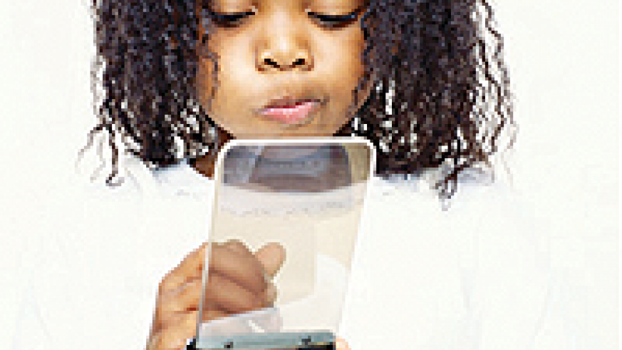 A young girl using a phone. Parents can teach children how to use phones for emergencies. Net photo.
