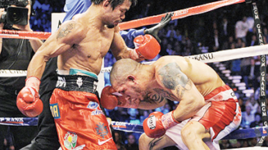 A rematch with Miguel Cotto (R) is one possibility for Manny Pacquiao on Nov. 10. Net photo.