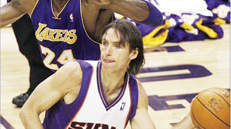 In this file photo, Phoenix Suns guard Steve Nash passes the ball with defender Los Angeles Lakers guard Kobe Bryant. Net photo.