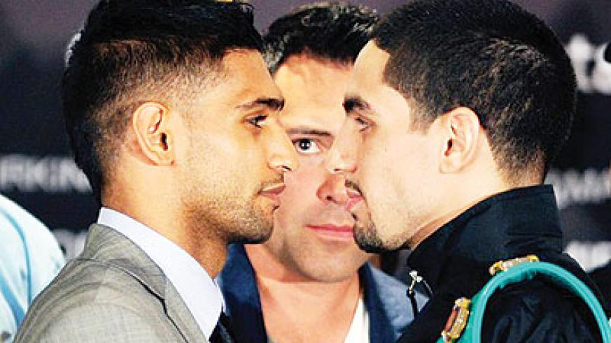 Khan will go into his light-welterweight unification bout with Danny Garcia on Saturday. Net photo.