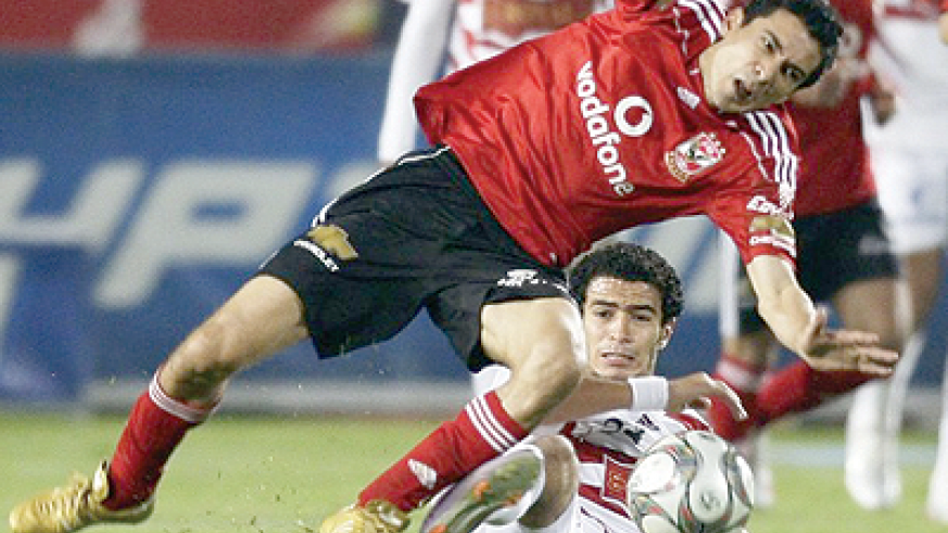 Al-Ahly's Mohamed Barkat (top) fights for the ball with El Zamalek's Omar Gabr during their Egyptian Premier League derby soccer match at Cairo Stadium. Net photo