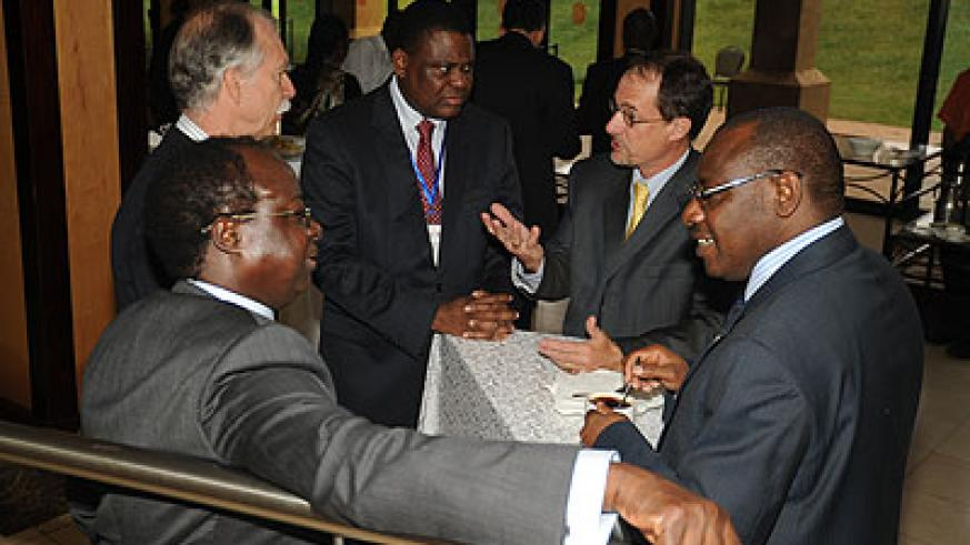 Seeking solutions. Experts chat during a recent meeting of African central bank governors in Kigali. The New Times / J. Mbanda.