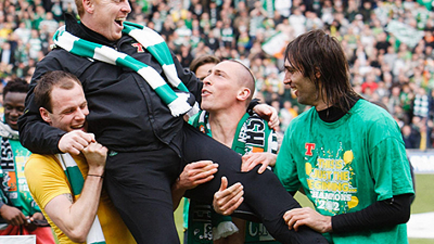 Celtic manager Neil Lennon is carried shoulder high by his players after winning last season's Scottish league. Net photo.