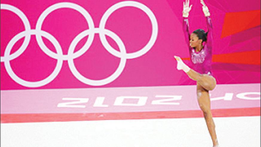 Gabby Douglas of the U.S. won the individual gold medal in the all-around gymnastics competition on Aug. 2, becoming the first African-American Olympic all-around champion. Net photo.