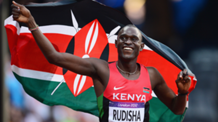 David Rudisha celebrates with the Kenyan flag after winning gold and setting a new world record of 1.40.91 in the men's 800m final at the Olympic Stadium on Thursday. Net photo.