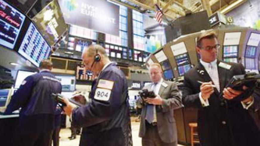 Traders work on the floor of the New York Stock Exchange. Reuters photo.