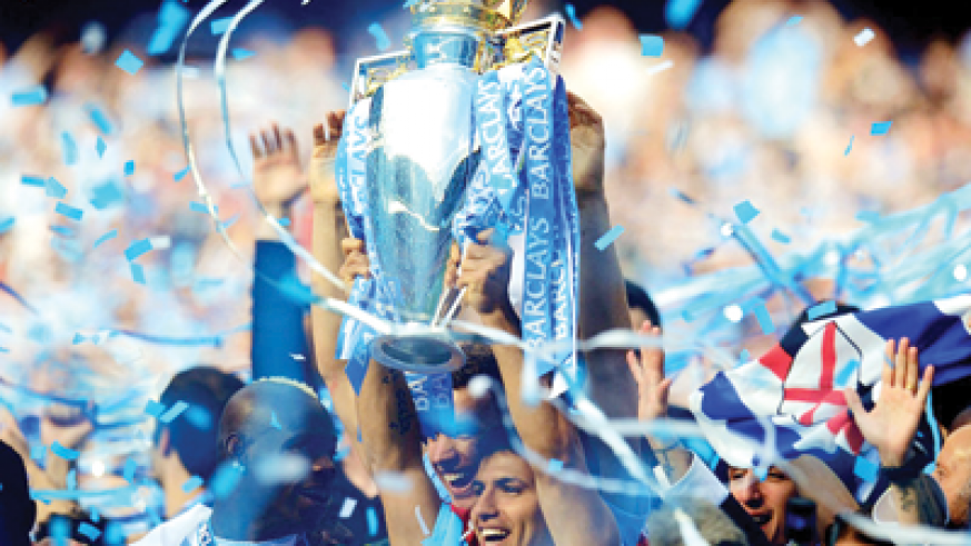 Manchester City clinched their first title for 44 years with Sergio Aguero's (lifting the trophy) last-minute winner in their final match against QPR. Net photo.
