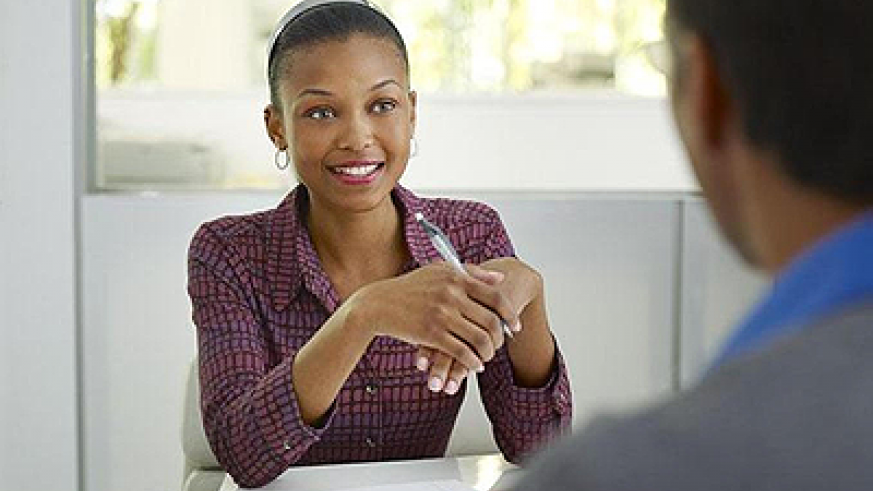 Use hand gestures and smile moderately during a job interview. Net photo.