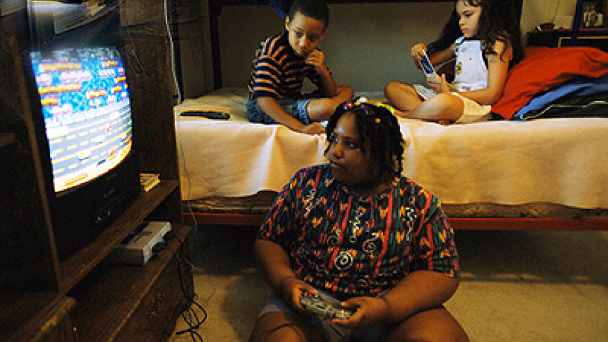 Encourage obese kids to engage in casual sports rather than sit home watching TV. Net photo.