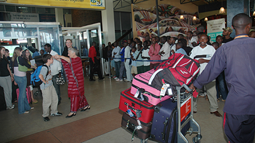 Passengers at Kigali International Airport. The service sector including transport and tourism industries boosted economic growth in the second quarter of this year.  The New Times / File.