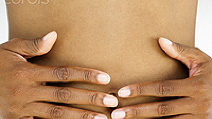 Massage your lower abdomen with your fingers to help with pain. Net photo.