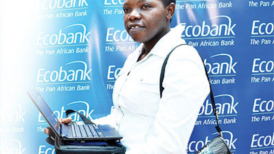 One of the Ecobank clients who won a laptop in the ongoing promotion.