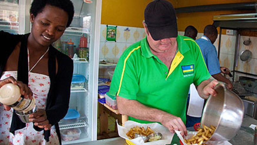 Paul Searby helping out in his Kimihurura restaurant