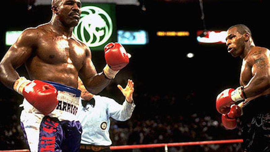 Evander Holyfield went 44-10-2 and defeated Mike Tyson twice, including the infamous 'Bite Fight on June, 28, 1997. Net photo.