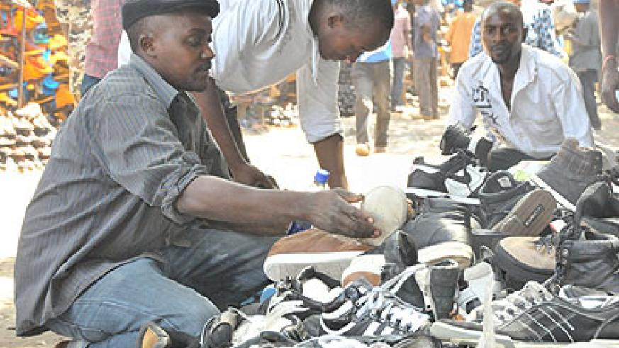 A trader sells shoes at Gikomba market in Nairobi, capital of Kenya. Small and medium traders can now afford open source softwares which enable them perform business processes like accounti