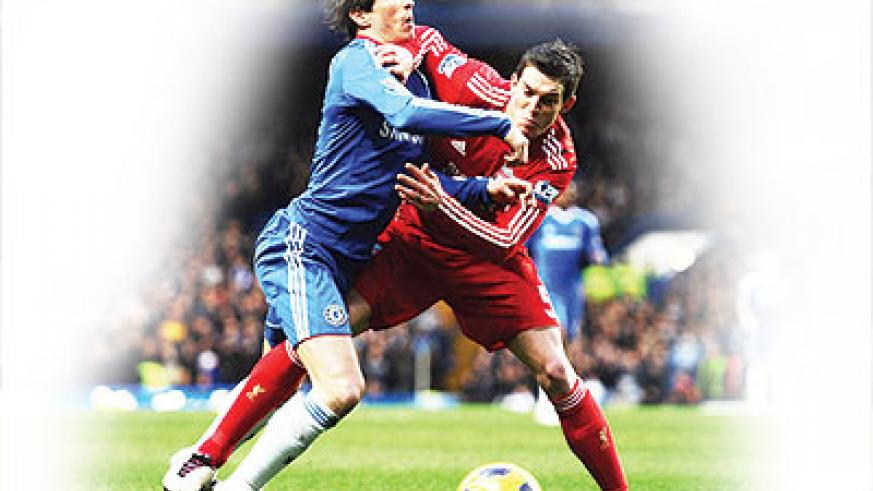 Fernando Torres of Chelsea is challenged by Daniel Agger of Liverpool last season. The two sides meet on Sunday at Stanford Bridge. Net photo.