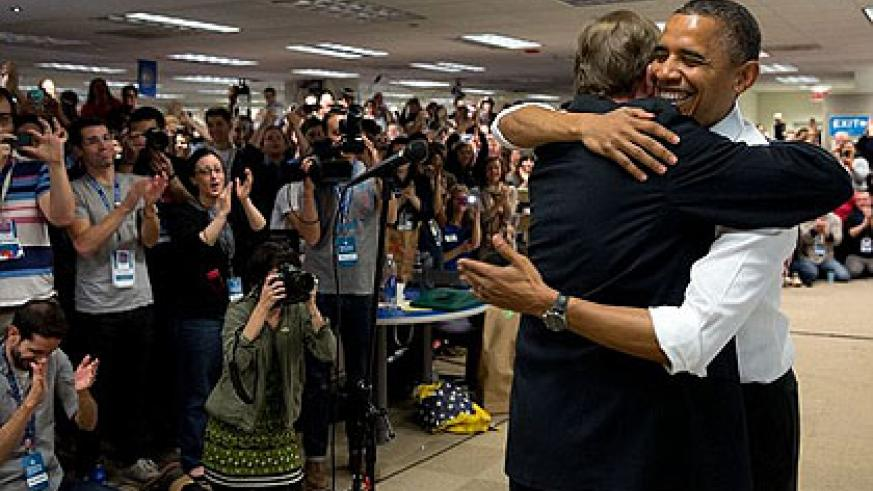 Minutes before: Obama is seen smiling as he hugs Jim Messina shortly before making his remarks. Net photo.