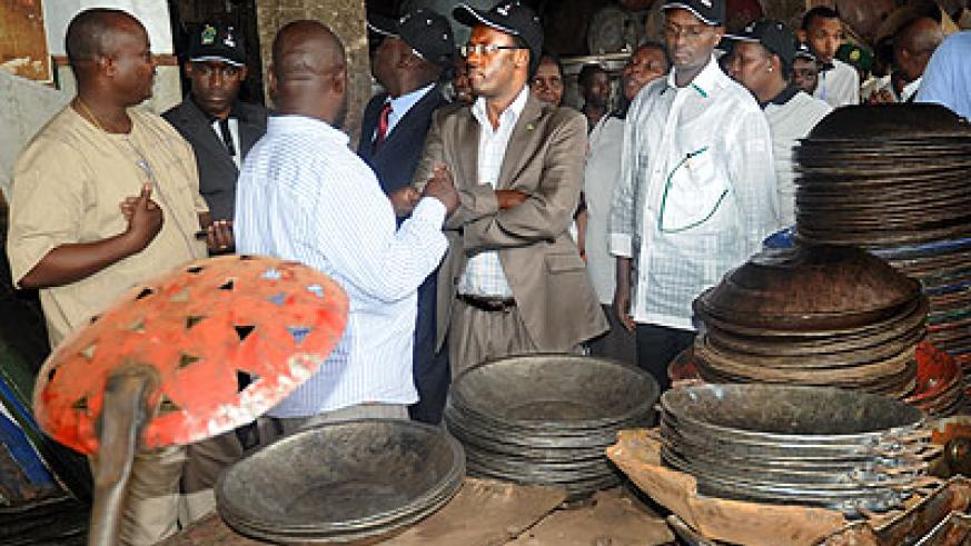 Governemnt officials inspecting Gacingiro in Kigali. The area is a workplace for many entreprenurs in Kigali city, mainly carpenters. The New Times / File.
