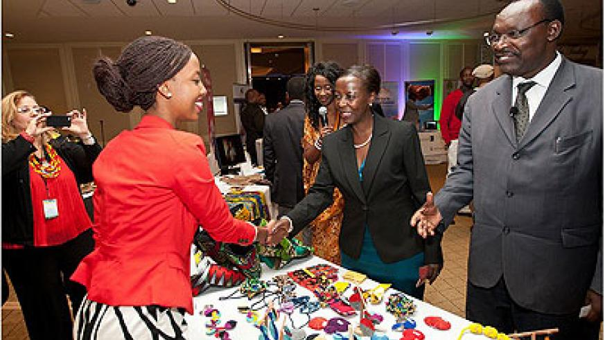 Teta Isibo welcomes ministers to her stand during the recent Rwanda Day in Boston, Massachusetts in the USA. The New Times / File.
