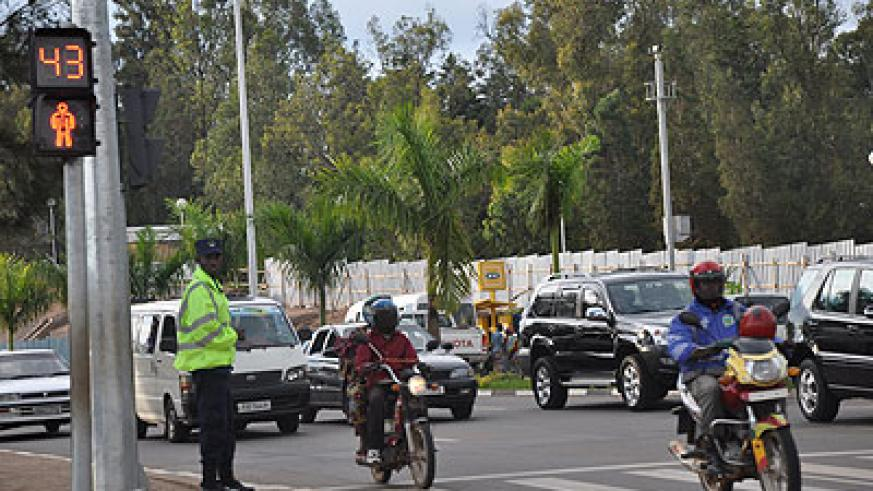 A traffic police officer monitoring traffic on a Kigali street.