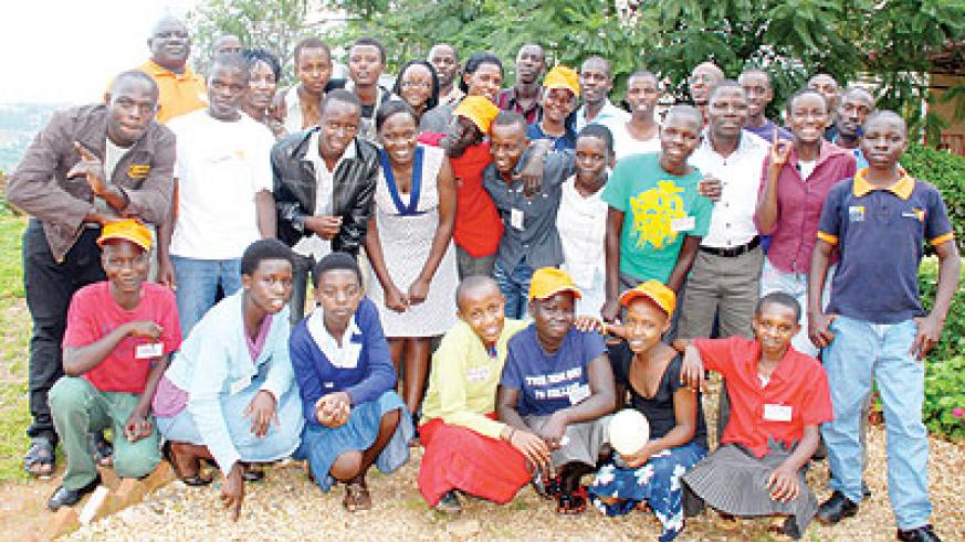 Students from Kenya, Uganda and Rwanda pose for a group photo after the conference. The New Times/Grace Mugoya