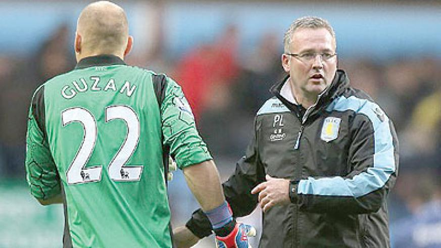 Lambert (right) believes Aston Villa's upcoming cup ties will ease the pressure on their Premier League worries. Net photo.