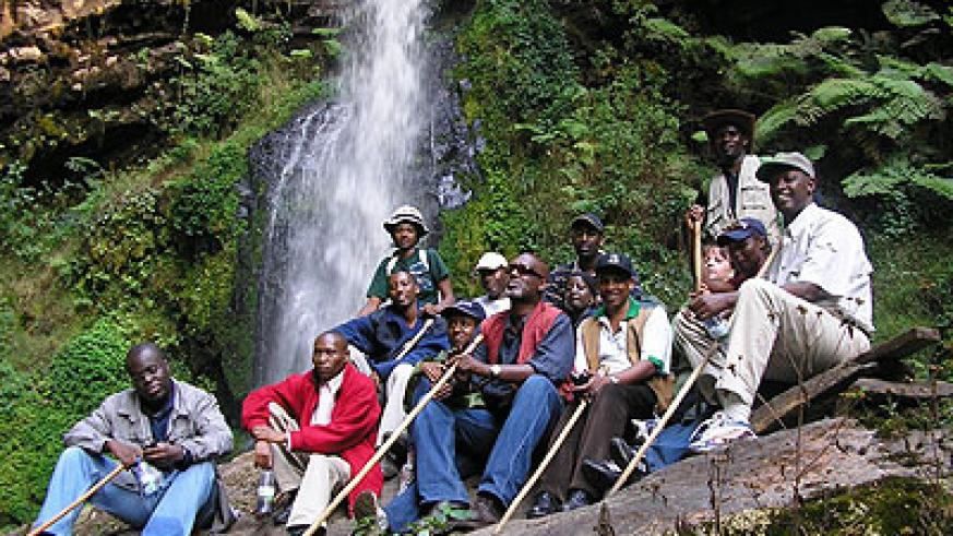 Tourists relaxing at a water fall. Rwanda is promoting different tourism products, including medical tourism.