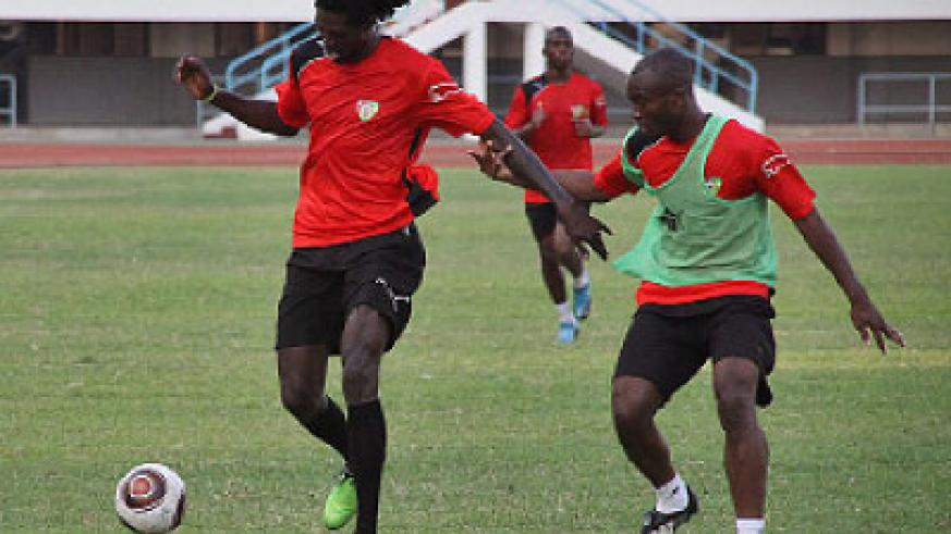 Togolese national team captain Emmanuel Adebayor (left) with his team mates during a training session. Togo know they need to beat Algeria to have any chance of progressing. Net photo.