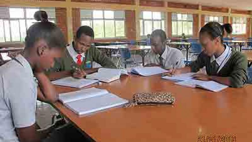 Students of Rivera High School revise in the school library . The New Times/ Allan B. Ssenyonga