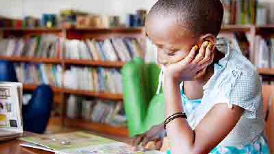 A pupil reads for pleasure in a school 			       library. Such readings enhance academic excellence. The New Times/ Timothy Kisambira