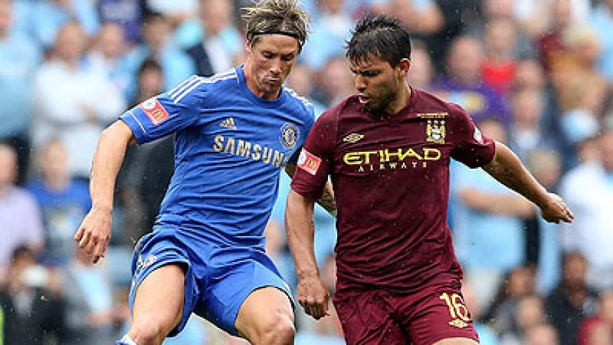 Chelsea manager will be hoping that Fernando Torres (L) can find his form against the champions, who have Sergio Aguero (R) back to full fitness. Net photo.