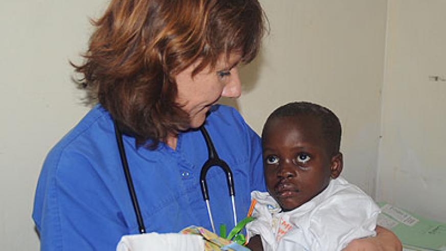 Florence Kuyt with one of her patients after a surgery. The New Times / J. Mbanda.