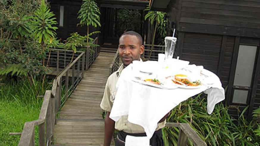 A waiter at Nyungwe Forest Lodge. The hotel is reaping from the five-star status it was awarded in the last grading exercise. The New Times/ Timothy Kisambira